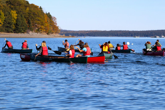 Mild temperatures, sunshine, and calm seas keep the outing club's 2015 canoe race calm and collected.