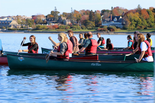 Eight teams compete in the COA outing club's 2015 canoe race to Bar Island and back. The race begins next to the COA pier.