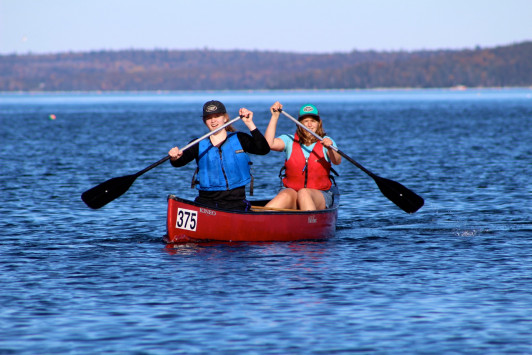 Abundant sunshine and the blue waters of Frenchman Bay make for pristine conditions for the annual canoe race.
