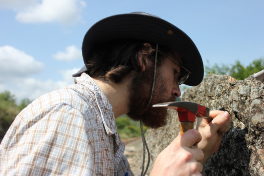Ian Medeiros '16 collecting lichen samples in South Africa.