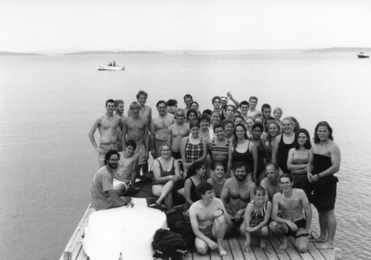 Professor Ken Cline and a group of early Bar Island swimmers, including professor Helen Hess, COA president Steve Katona, and long-time registrar Sally Crock, 1990s.