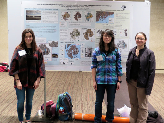 "Alba Mar Rodríguez Padilla '18, left, Gemma Venuti '18, and COA Anne T. and Robert M. Bass Chair in Earth Systems and GeoSciences Dr. Sarah Hall present their work, ""Glacial erosion and pre-existing fracture networks collaborate to create the Acadia National Park landscape,"" at the Northeastern Section of the Geological Society of America's 51st annual meeting in Albany, NY."