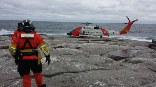 A U.S. Coast Guard helicopter was used to evacuate a College of the Atlantic student and three government researchers from remote Mount Desert Rock, 25 miles offshore, on Friday.