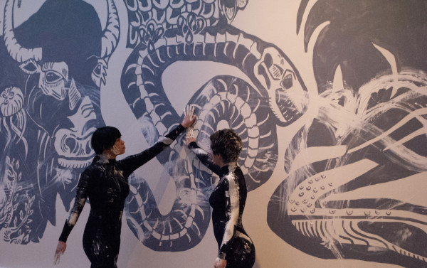 Shir Orner and Emily Engelking-Rappeport perform a dance to initiate the destruction of the mural.