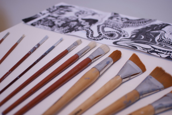 Tools: the design template for the mural and the brushes.