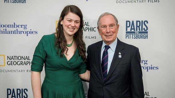 Iris Fen Gilligham '22 with former mayor of New York City Michael Bloomberg at the premiere ...