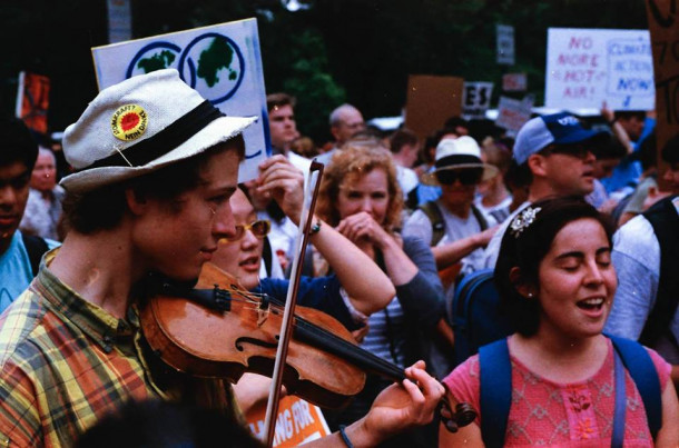 "<span style=""font-weight: 400;"">College of the Atlantic student Ángela Valenzuela '17, right, performs with COA student Augustin Martz '17 at the New York City People's Climate March in 2014.</span>"