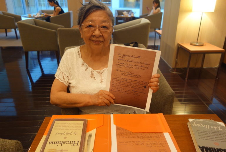 Koko Kondo holds up the manuscript written by her father, Reverend Kiyoshi Tanimoto, that inspire...