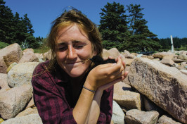 "Meaghan Lyon '16 holds a black guillemot chick during ""chick check."""