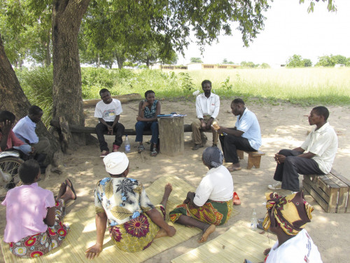 In Manica, Mozambique, Helena Shilomboleni '09 (center back, in blue) listens to beneficiaries of AGRA, the Alliance for a...