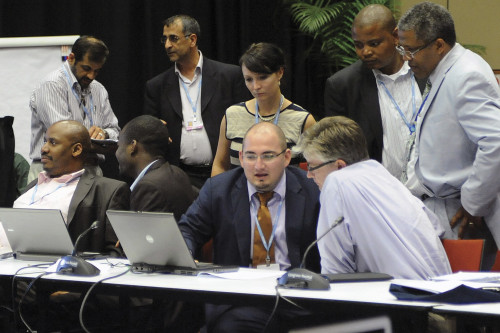 Negotiating for the G-77 in 2011, Juan Hoffmaister '07, seated, second from right, consults on national adaptation plans...