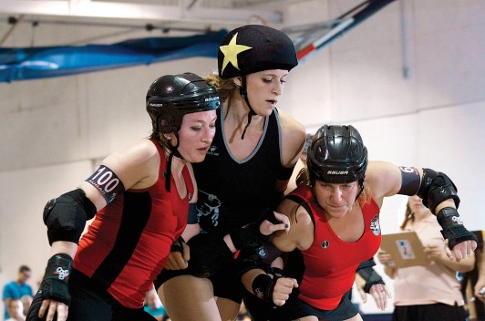 Former COA development staffer Carla Ganiel, aka Surly Jackson, on the right, keeping the Chicago Outfit's jammer from scoring. Carla was playing in Chicago for the DC Rollergirls' traveling B-team, the National Maulers.