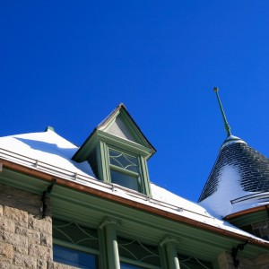 Turrets roof and blue sky in winter