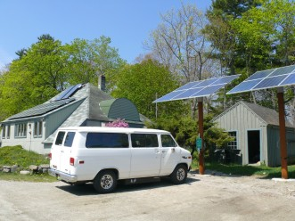 The e-van charges up at the solar electric car charging station on the north end of campus.
