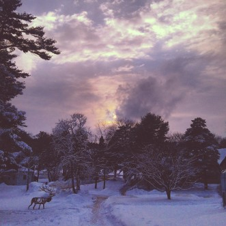 Dusk over a snowy campus.
