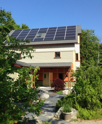 Solar panels on the roof of one of the residences in the Kathryn W. Davis Village.