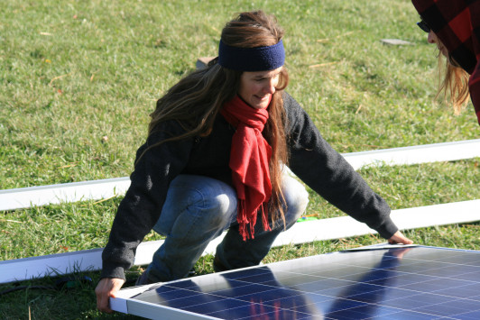 Students installing solar panels at COA's Beech Hill Farm.