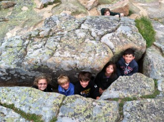 Young family campers discover a cool cave in Acadia National Park