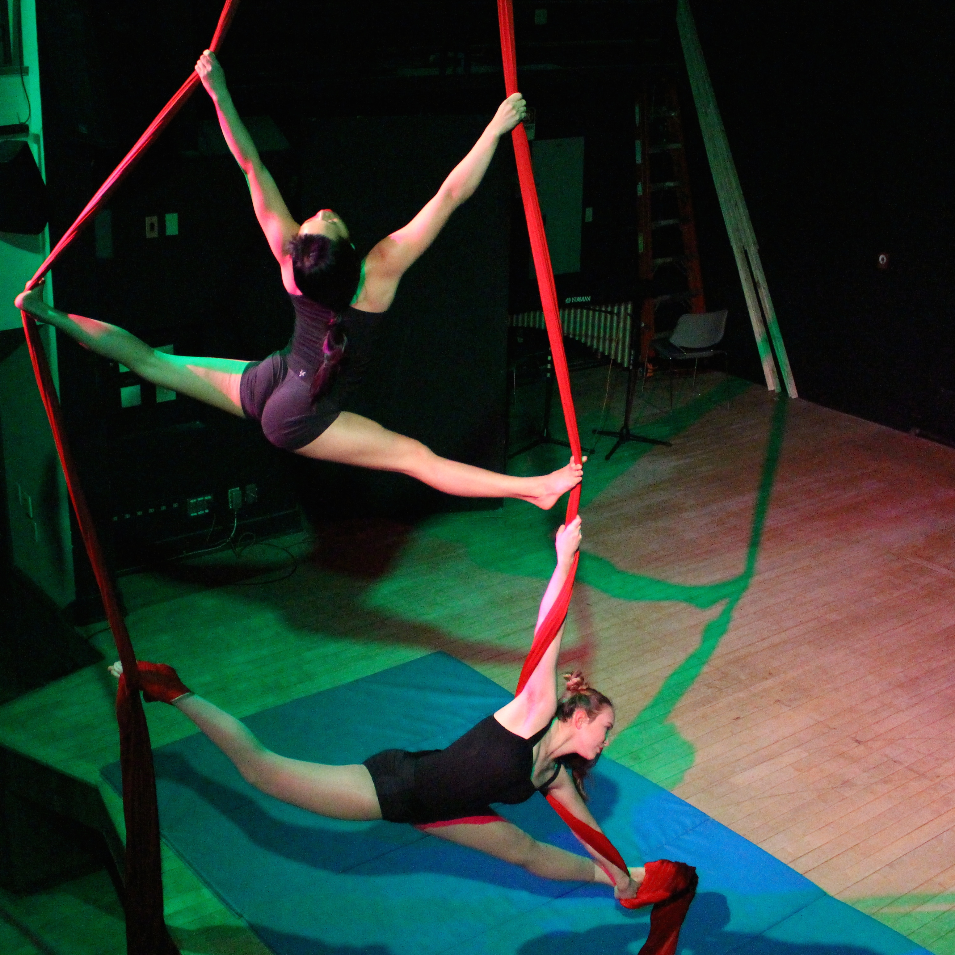 Emily Engelking-Rappeport '17, top, and Ursula Ostrander '18 perform a duo aerial silk act during the annual COA Fandango, held recently in the Thomas S. Gates, Jr. Community Center.  #aerial #acrobatics #silk #performance #dance #collegeoftheatlantic #springterm #performingarts #students #collegestudents #collegelife #entertainment #lifechanging #worldchanging #photocred: Junesoo Shin '21