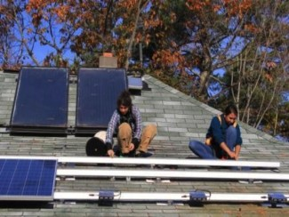 Students install rooftop solar photovoltaic panels at COA as part of the 2011 Practicum in Renewa...