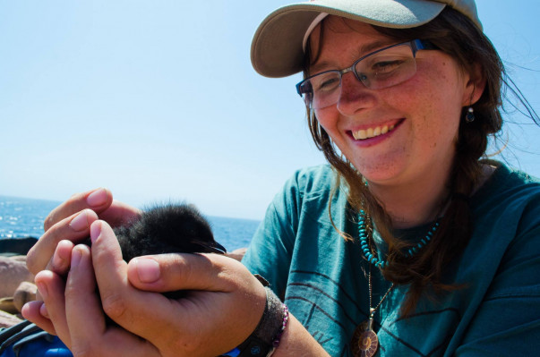 Nina holding Black Guillemot Chick